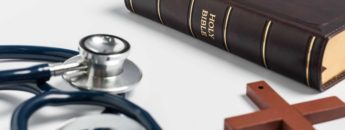 Bible, cross and stethoscope