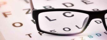 Glasses sitting atop an eye test chart