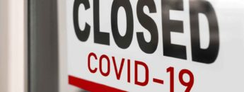 sign reads 'closed covid-19'